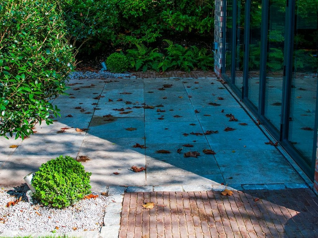 rear patio with camel ancienne belgique clay bricks next to porcelain paving