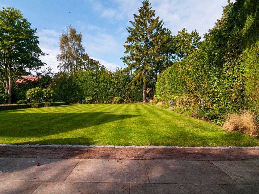 main lawn and patio with clay bricks and porcelain paving