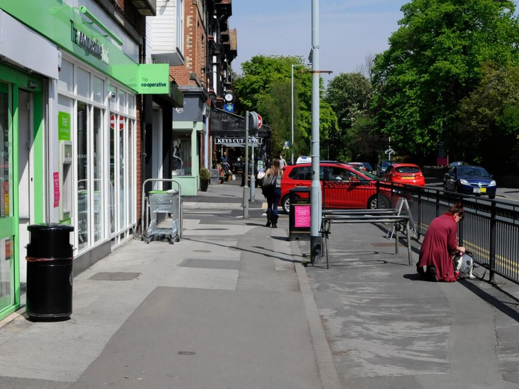 View of Heaton Moor Road, outside of the Co-op before pavement upgrade.