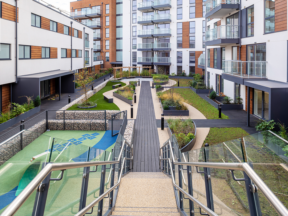 stairs from second floor roof garden to first floor roof garden on central axis through roof gardens which runs through curved raised beds and play area