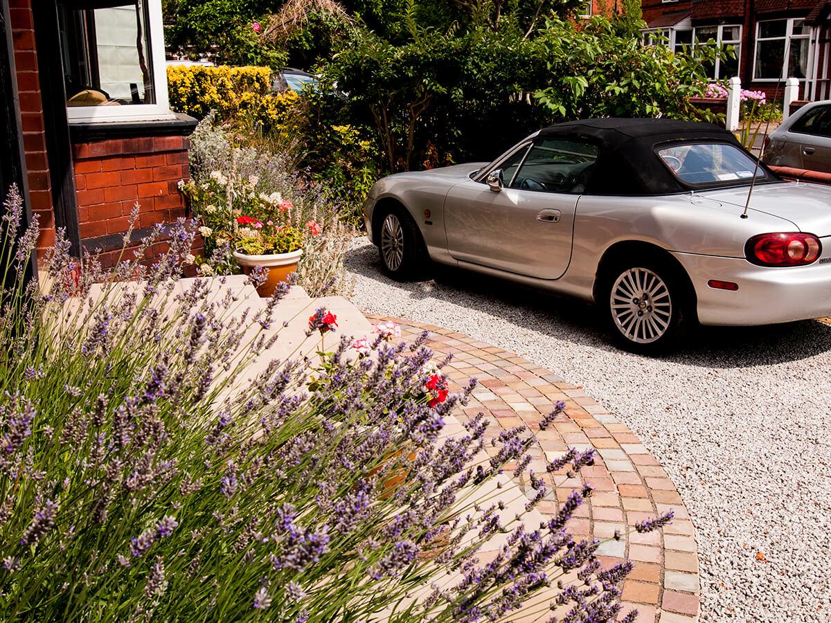 lavender in front of biullnosed sandstone steps radial setts and silver granite gravel and mazda