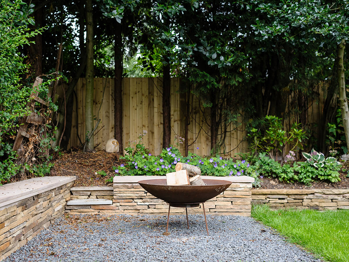 stone seating wall and corten steel fire pit