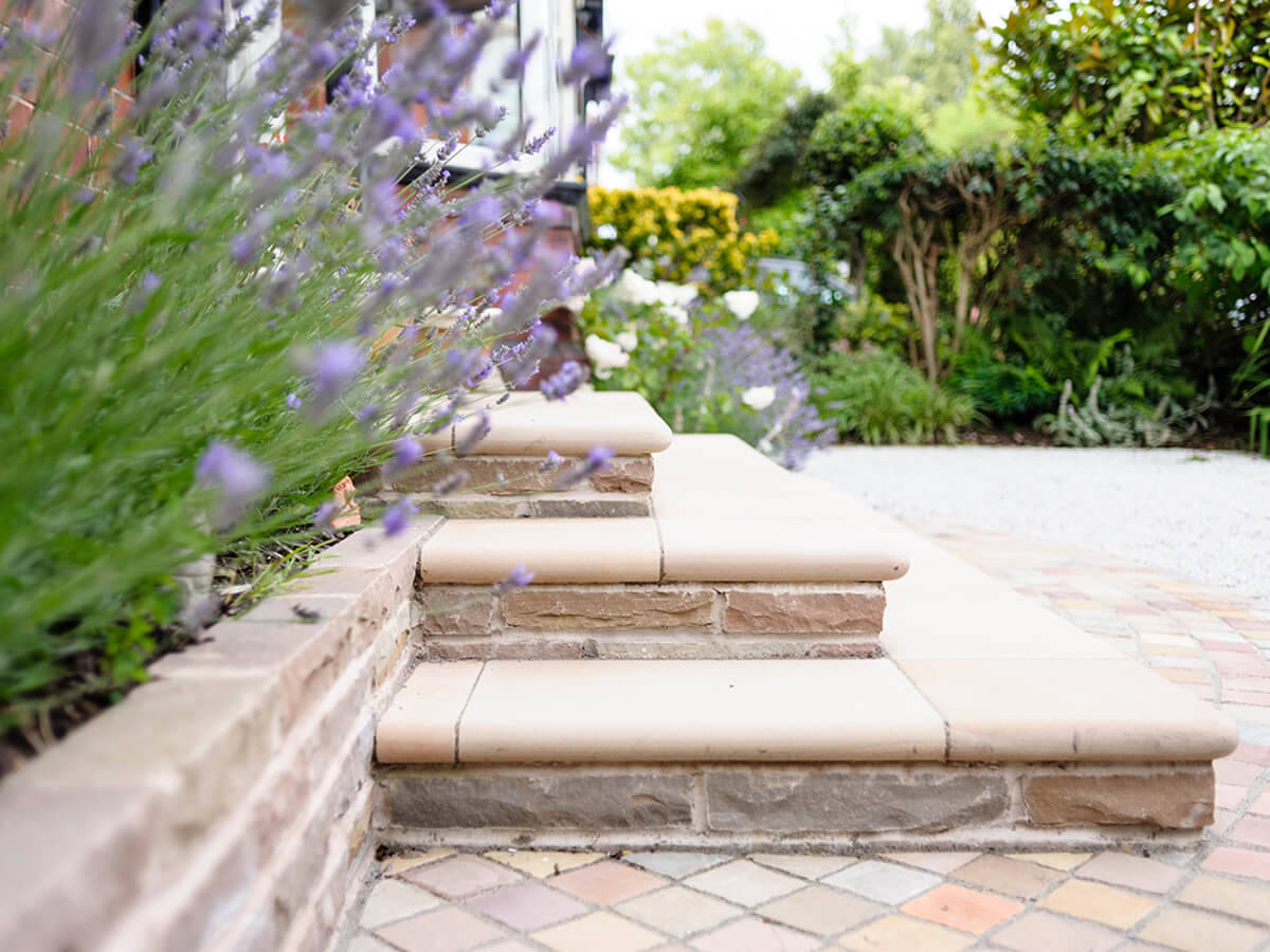 front door steps with bullnose and out of focus lavender