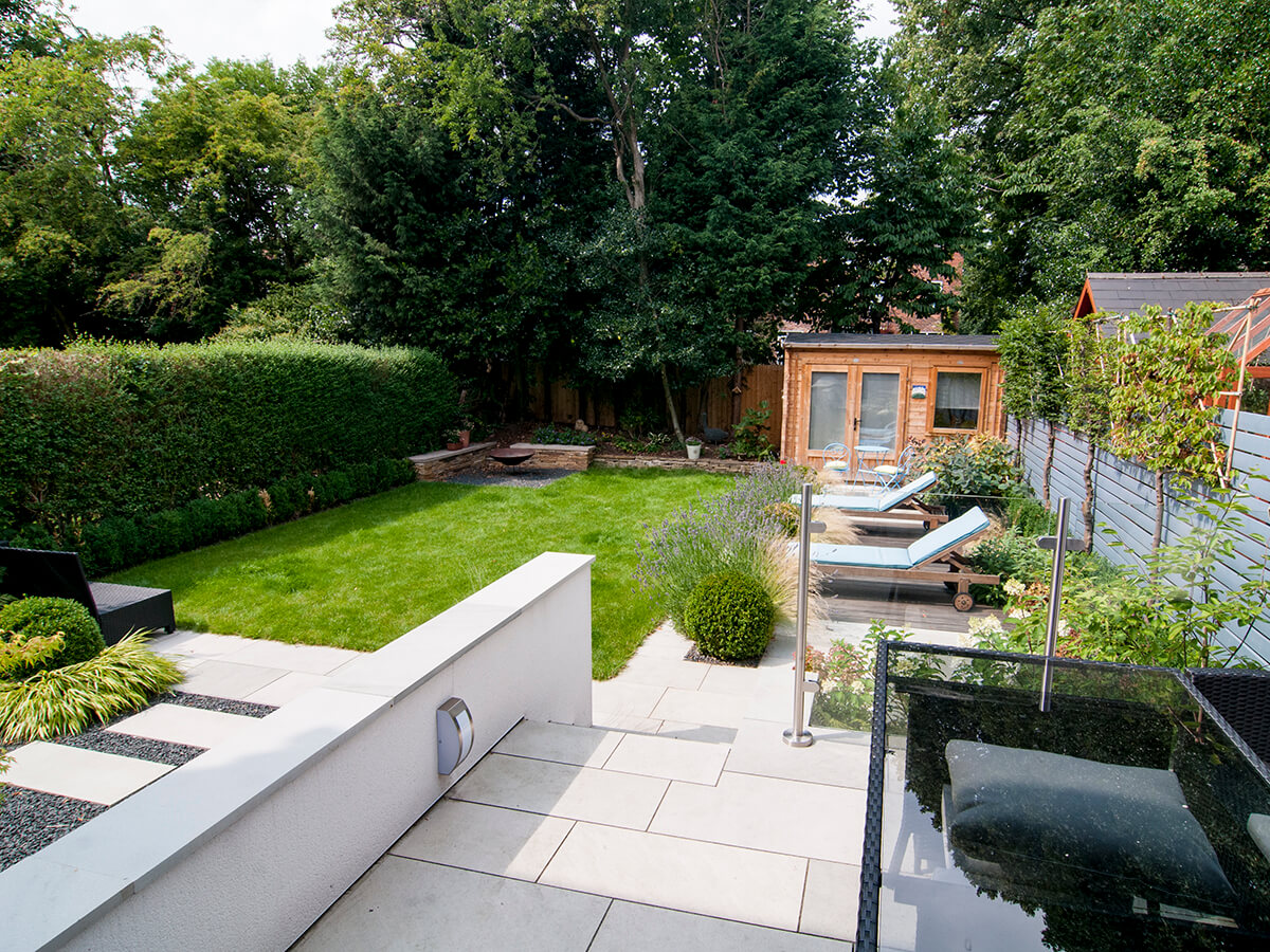 natural dimensions garden design, grey sandstone, white render, stepping stones, pleached trees