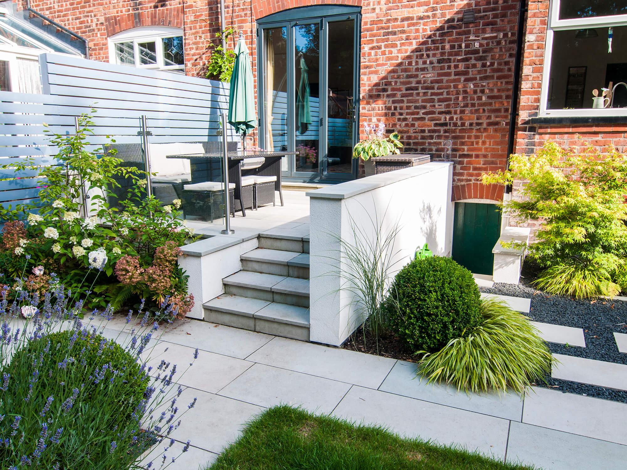 natural dimensions garden design, raised patio, stepping stones, HERO