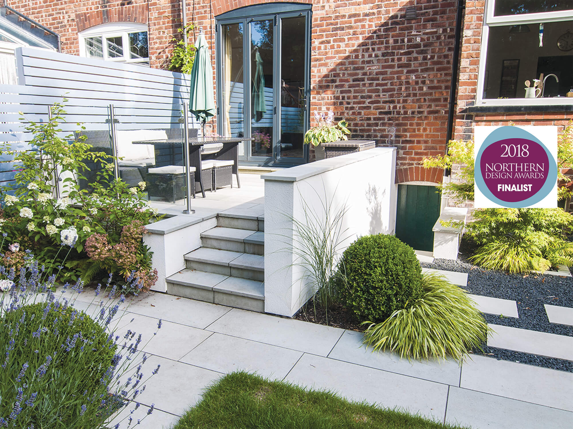 Raised patio with box balls and hydrangea, Japanese stepping stones and basalt gravel Northern Design Awards finalist