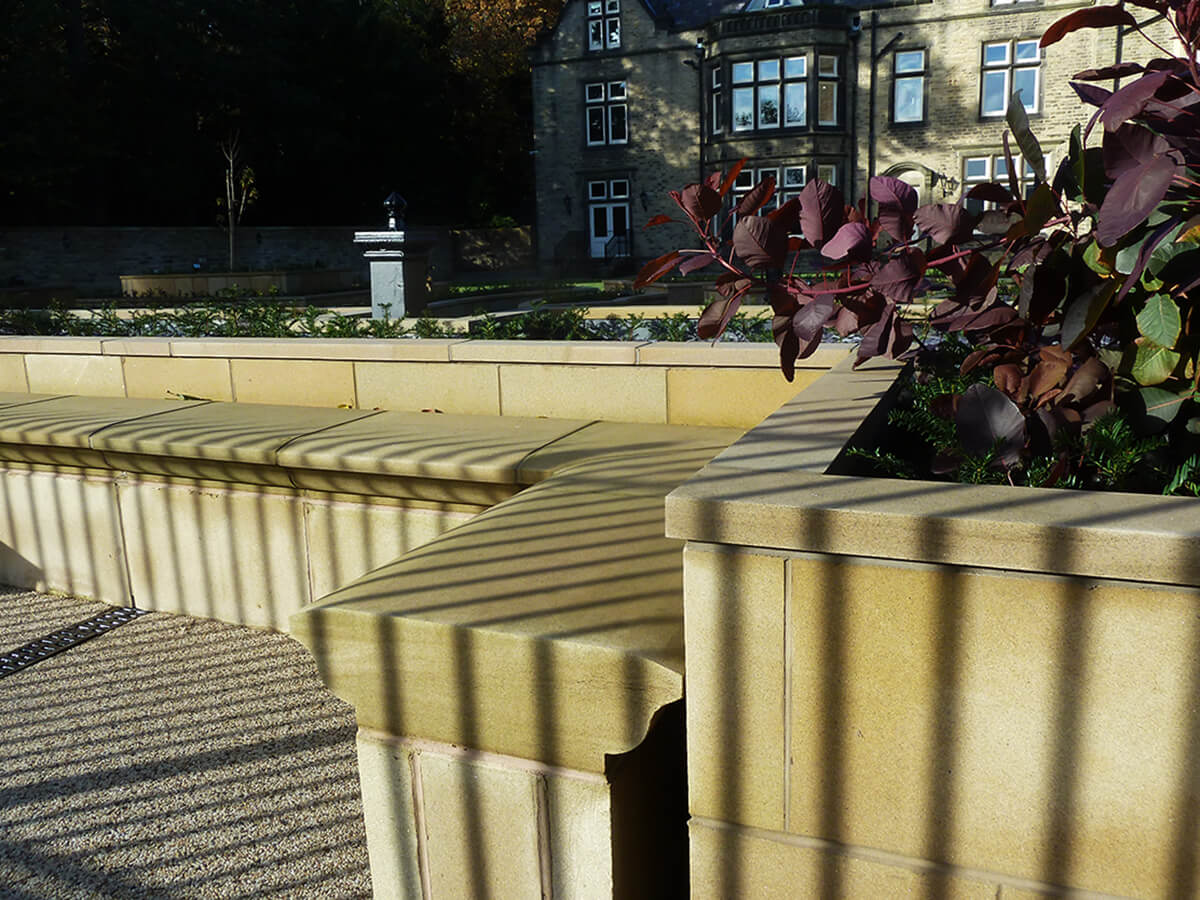 View of raised planter stone work and seating ledge.