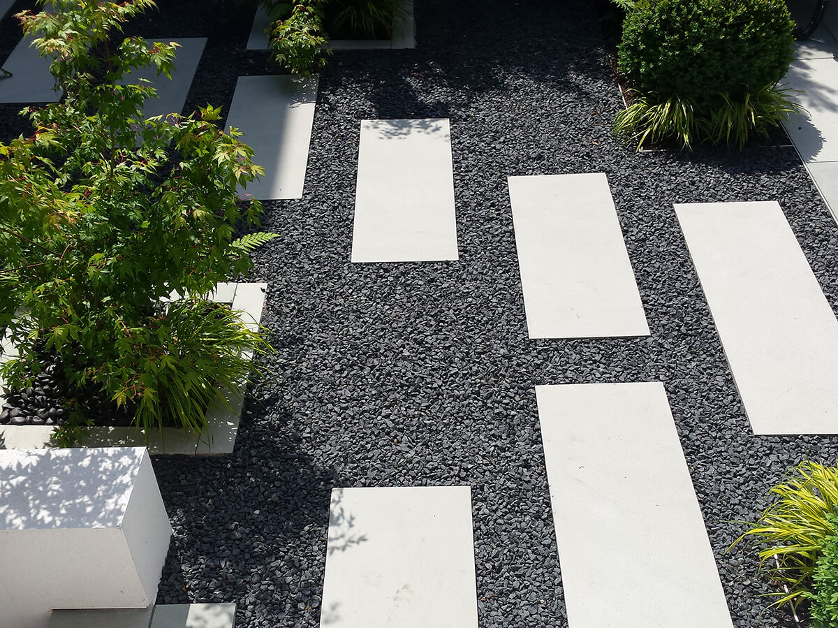 stepping stones and Japanese forest grass, acer palmatum katsuri, box ball and black gravel