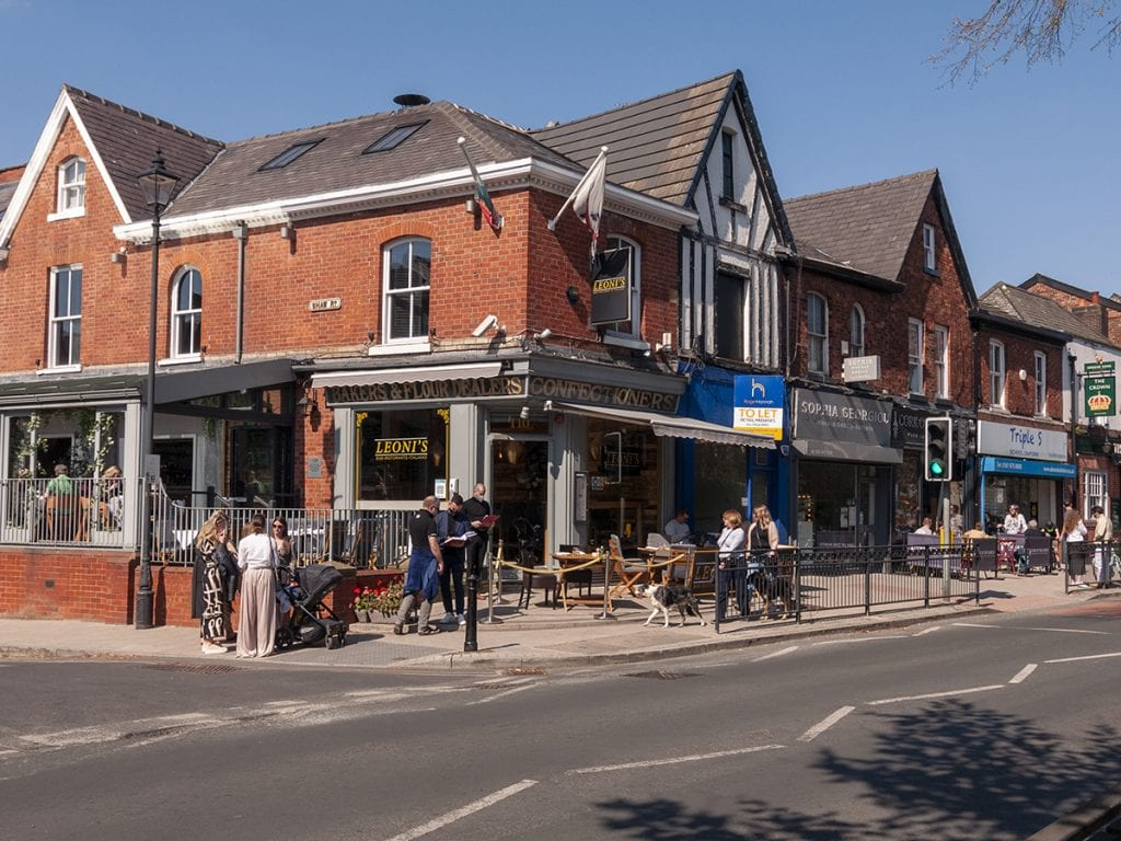 people drinking at Leoni's and Cork of the North outdoor seating street on Heaton Moor Road post lockdown