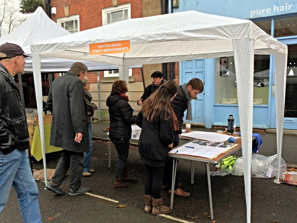 Nicholas Atherton of Natural Dimensions undertaking  in community consultation for Shaw Road improvements in a tent