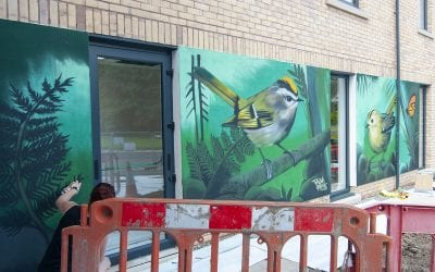 WALL ART GOES IN AT ASSISTED LIVING PROJECT
