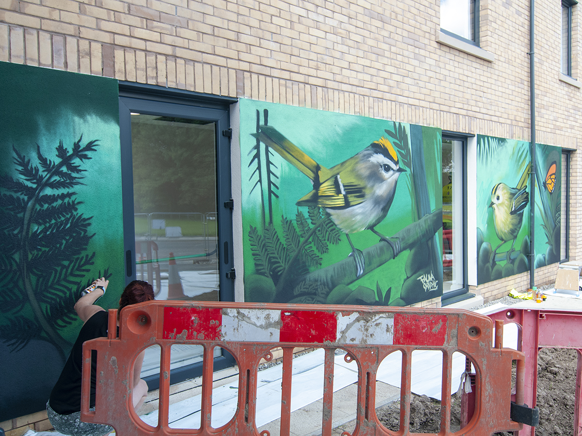 painted mural of goldfinch